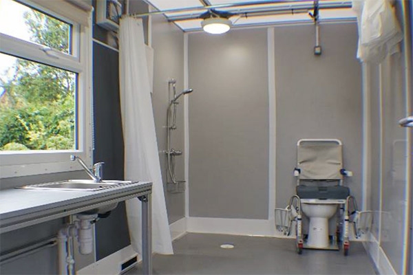 The Temporary Storage Group accessible shower room with window